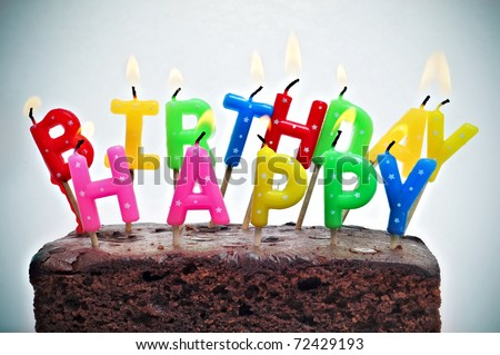 birthday cake with candles forming the sentence happy birthday
