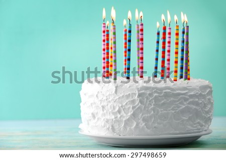 Shutterstock Birthday cake with candles on color background