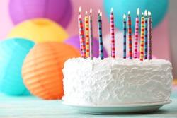 Birthday cake with candles on colorful background