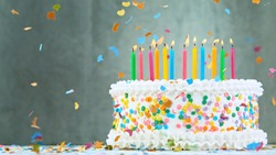 Birthday cake with candles on pastel blue background
