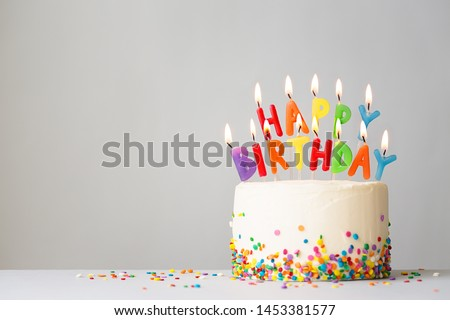 Birthday cake with colorful candles spelling happy birthday #1453381577