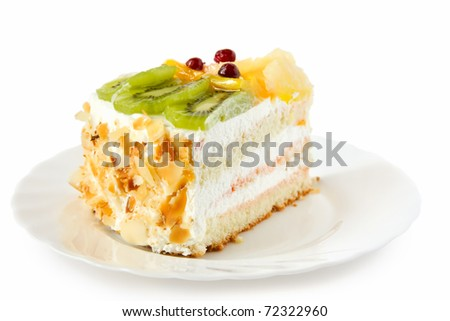 Birthday cake with cream with fruit on the white background