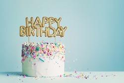 Birthday cake with gold happy birthday banner