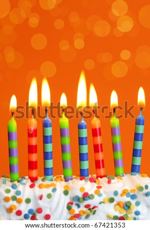 Birthday candles on brown background