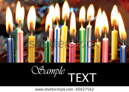 Birthday candles on chocolate cake with copy space.  Macro with shallow dof.