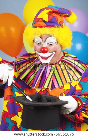 Birthday clown performing a magic act with a tophat and wand.