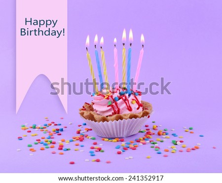 Birthday Cup Cake With Candles And Colorful Sparkles On Purple Background 241352917