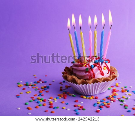 Birthday Cup Cake With Candles And Colorful Sparkles On Purple Background 242542213