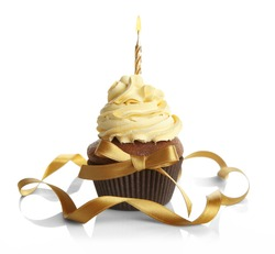 Birthday cupcake and ribbon on white background