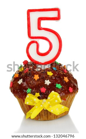 Birthday cupcake with chocolate frosting isolated on white