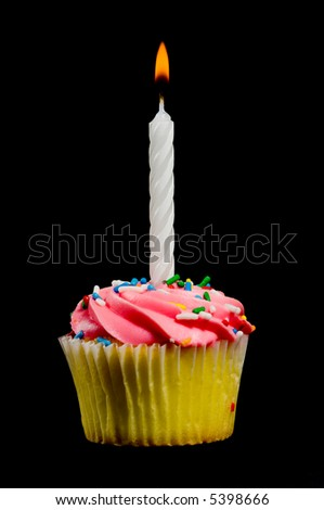 Birthday Cupcake with frosting and a candle on a black background