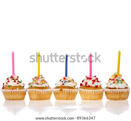 birthday cupcakes with colorful  sweet sprinkles and  candle on white  background