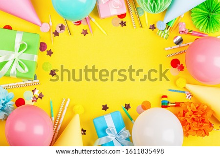 Birthday decor on yellow background, top view. Flat lay style. Mockup, template