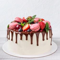 Birthday Drip Cake with chocolate ganache and fresh berries.