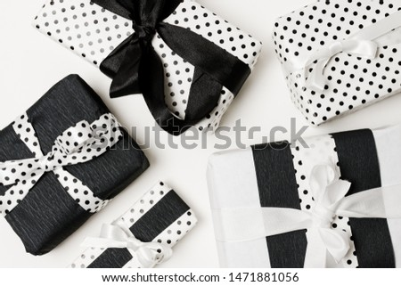 Birthday gifts presents box wrapped with white and black beautiful polka dots paper