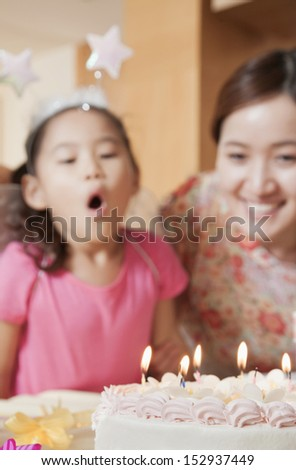Birthday Girl About to Blow Out Her Candles