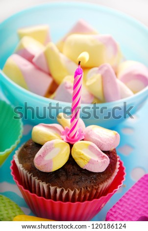 Birthday Muffin Cake Decorated With Marshmallow Flower And One Candle ...