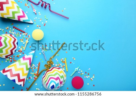 Birthday paper caps with candles and straws on blue background #1155286756