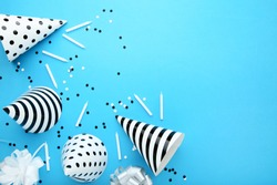 Birthday paper caps with candles on blue background