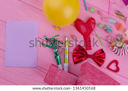 Birthday party accessories and blank paper card. Balloons, blowers, candies and other decorations for kids Birthday party.
