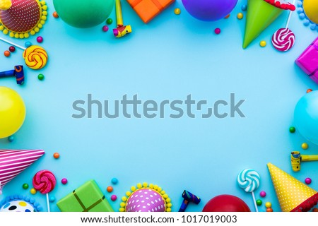 Birthday party background with party hats and candy #1017019003