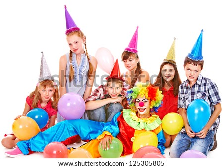 Birthday party group of teen people with clown. Isolated.