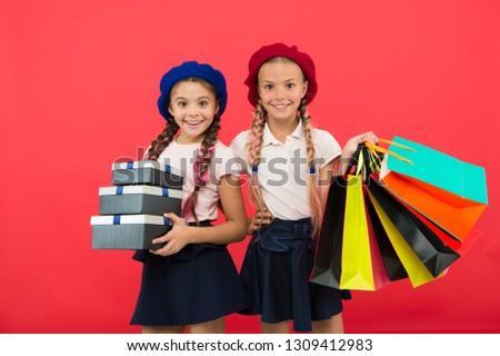 Birthday present. Shopping and holidays. For my dear friend. Girl giving gift box to friend. Girls friends celebrate holiday. Children formal wear with gift box. Open gift now. Friendship concept.
