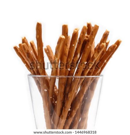 Biscuit sticks,Pretzel sticks in the glass on white background