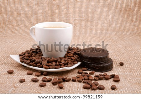 biscuits and grains of lie on a saucer on a background sacking