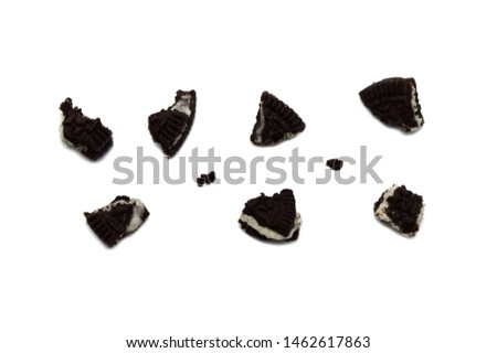 Biscuits with crumbs isolated on white background. It is a sandwich cookies filled with chocolate cream flavored.