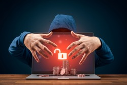 Bitcoin and cryptocurrency cybersecurity concept with hacker behind the unsecured laptop.