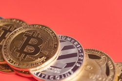 bitcoin BTC and Dogecoin DOGE group included with Cryptocurrency coin , Ethereum ETH, Bitcoin Cash bch, Litecoin LTC symbol Virtual blockchain technology future is money lose Closeup on red background