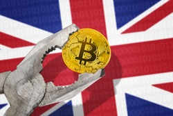BITCOIN (BTC) coin in a vice under pressure on United Kingdom flag background. Prohibition of bitcoin cryptocurrency; regulations; restrictions or security
