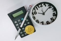 Bitcoin, clock and calculator. Cryptocurrency time tax return concept. copy space.