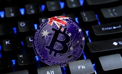 Bitcoin close-up on keyboard background, the flag of Australia is shown on bitcoin.