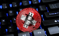 Bitcoin close-up on keyboard background, the flag of Switzerland is shown on bitcoin.