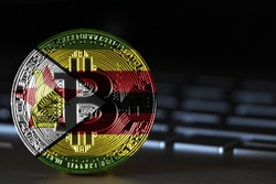 Bitcoin close-up on keyboard background, the flag of Zimbabwe is shown on bitcoin.