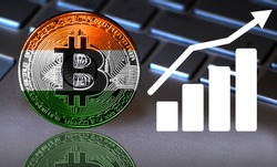 Bitcoin close-up on the keyboard background, the India flag is shown on the bitcoin.