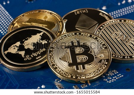 Bitcoin coin symbol on blue electronic circuit board background. Close-up, blue background. Business, money, cryptocurrency concept