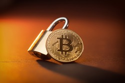 Bitcoin crypto currrency coin and a padlock, crypto shutdown and fall due to Coronavirus global pandemic crisis, stock and economy fall due to uncertainty and anxiety, unstable situation and future