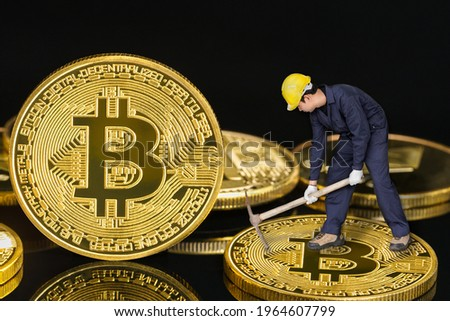 Bitcoin cryptocurrency digital bit coin BTC currency concept ,Bitcoin mining worker holding mattock digging golden Bitcoin crypto currency coin on a black background Stock photo ©