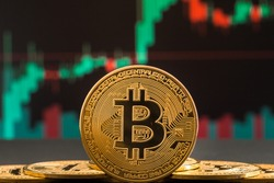 Bitcoin cryptocurrency gold coin. Trading on the cryptocurrency exchange. Trends in bitcoin exchange rates. Rise and fall charts of bitcoin.
