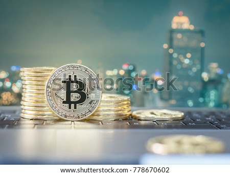 Bitcoin cryptocurrency gold stack coins virtual digital currency for financial banking business and world stock exchange investment via internet online computer technology energy consumption concept