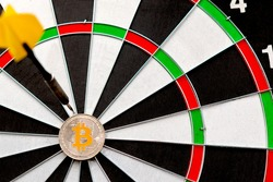 Bitcoin cryptocurrency in the center of darts. Right on target.