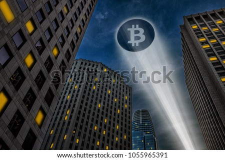 Bitcoin cryptocurrency logo projected on the sky by a beam of light, through city skyscrapers at night, Bitcoin as people saviour superhero concept