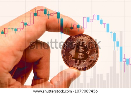 Bitcoin exchange financial chart with mam holding bitcoin. crypto exchange ticker and rise fall chart,Business and sign or symbol concept. Foto stock ©