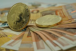 Bitcoin gold - Bitcoin BTC Cryptocurrency Coins. Stock Market Concept. BTC to USD Cryptocurrency Bitcoin BTC - Euro banknotes  background