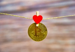 Bitcoin hanging with red heart isolated on white background.Coins for business sell and trade. Bit coin Mining or block chain technology for crypto currency. Modern electronic money for virtual