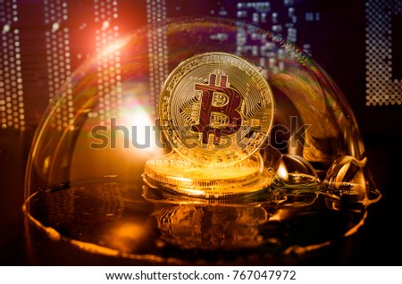 Bitcoin in a soap bubble on video card background. Dangers and risks of investing to bitcoin. Speculation