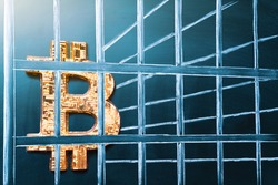 Bitcoin in prison. Concept of arrest, fraud and deception with cryptocurrency and mining. Bitcoin ban, imprison or illegal. Big troubles for bitcoin.